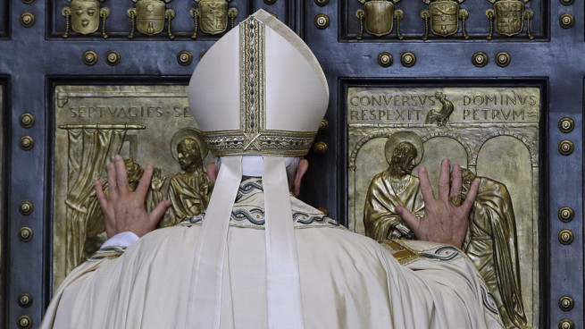 Pope Francis pushes open the Holy Door of St. Peter's Basilica